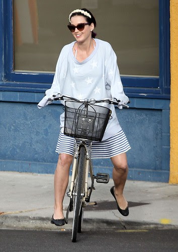 1 katy perry rides a bike