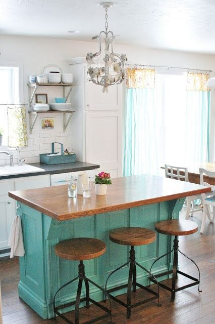 Love this Farm Kitchen  paint our island/bar a good color. :)