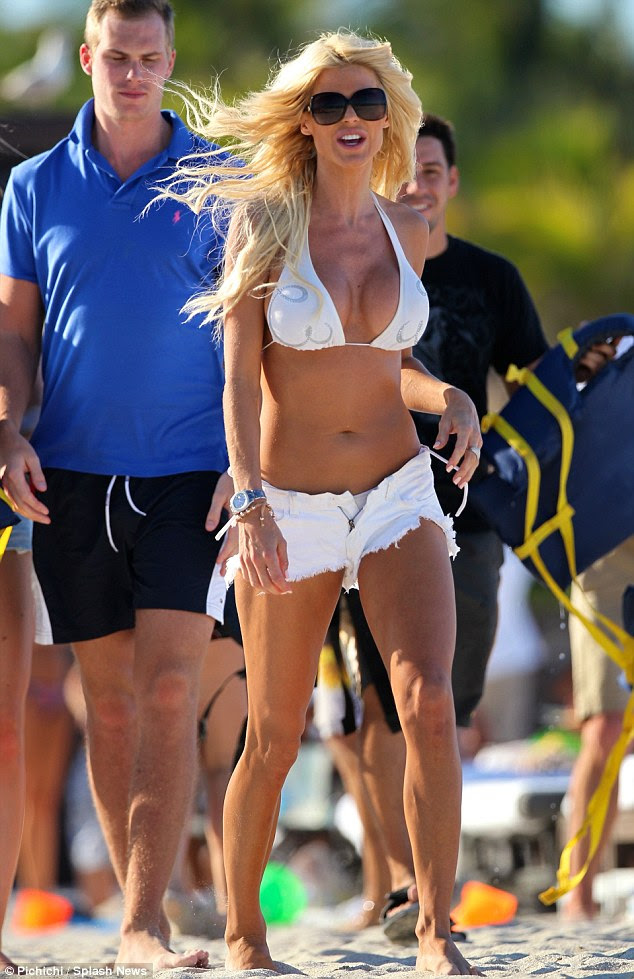 Curvy: Victoria Silvstedt does cover up later... by donning a pair of very short shorts which catch the eye of other sunbathers