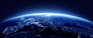 Earth at night as seen from space with blue, glowing atmosphere and space at the top. Perfect for illustrations. Elements of this image furnished by NASA