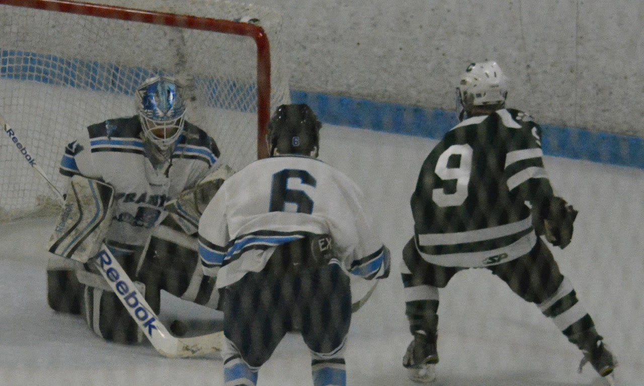 Franklin goalie Nick Jasinski (31) denies Canton forward Matt Lazaro (9) in the second period on Saturday. (Josh Perry/HockomockSports.com)