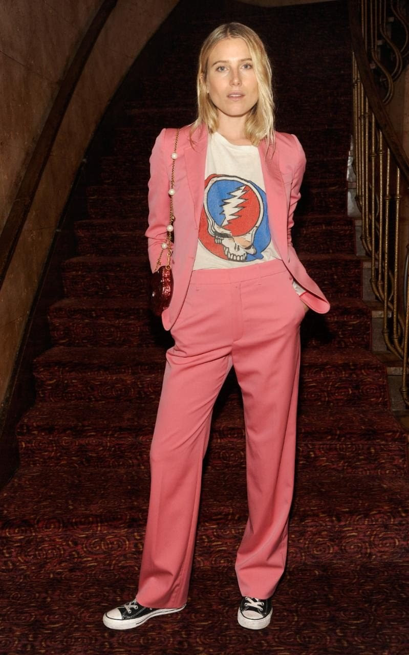 Dree Hemingway dressed down her pink Gucci trouser suit with Converses and a band t shirt