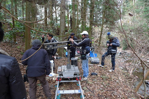 Me setting up a shot in the forest