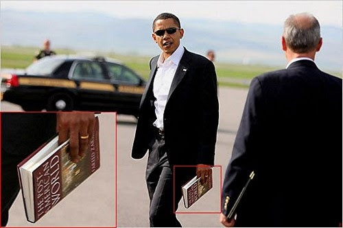 Take a look at the book Obama is reading. It was written by a Muslim and is about an Islamic America.
