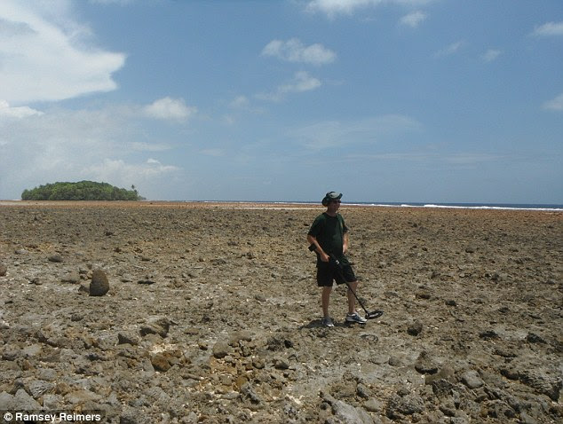Off course: One of the theories is that they landed on the coral shore of a small atoll in the Marshall Islands - a theory Dick Spink (pictured on the island) and Les Kinney hope to prove after finding a piece of metal