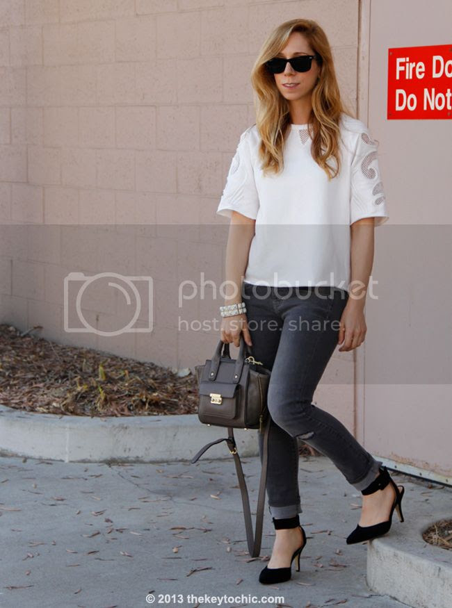 embellished sweatshirt from Crossroads Trading, Mossimo skinny jeans, Luichiny Law Rence heels, and Phillip Lim for Target taupe mini satchel