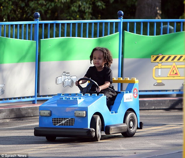 Beep beep! The tot looked focused on the road ahead as he went for a spin