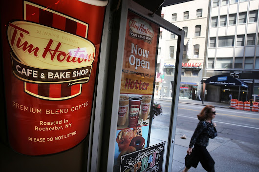 Burger King to buy Tim Hortons; new firm to be based in Canada