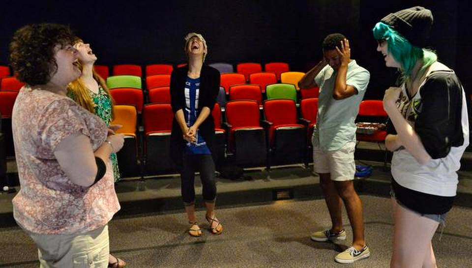"""Before rehearsal at the Coterie, the cast and co-director Tara Varney (left) burst out laughing during an improvisational game called """"What are you doing?"""" The game is meant to free up their creative impulses and help them not think too much but react quickly."""