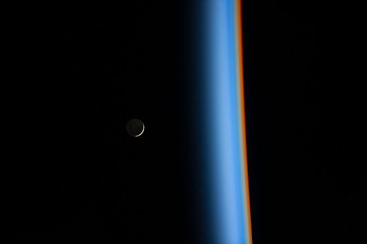Crescent Moon Rising and Earth's Atmosphere