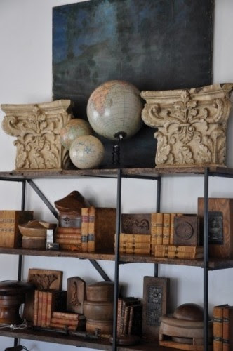 Old world elements on the bookshelf.  Makes if very interesting.