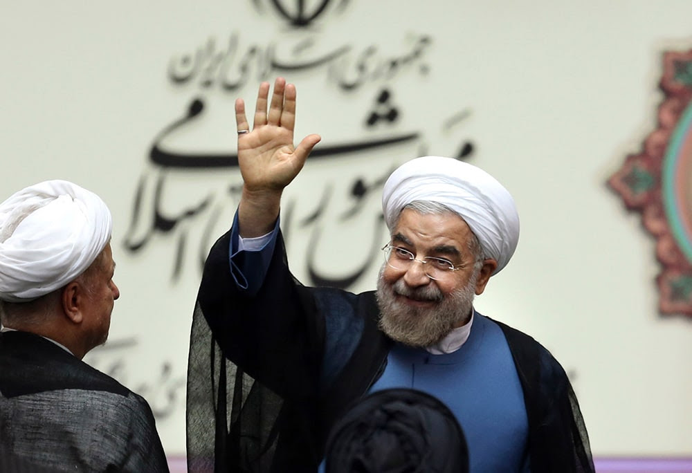 Iran's new President Hasan Rouhani, waves after swearing in at the parliament, in Tehran, Iran. (AP Photo/Ebrahim Noroozi)