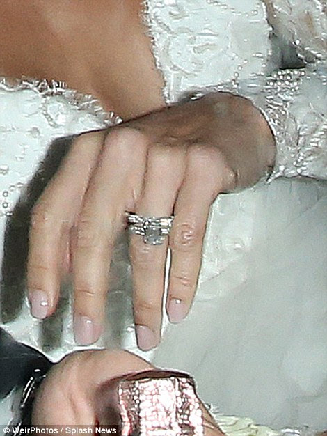 She's a taken lady: Christine proudly showed off her sparkling wedding ring