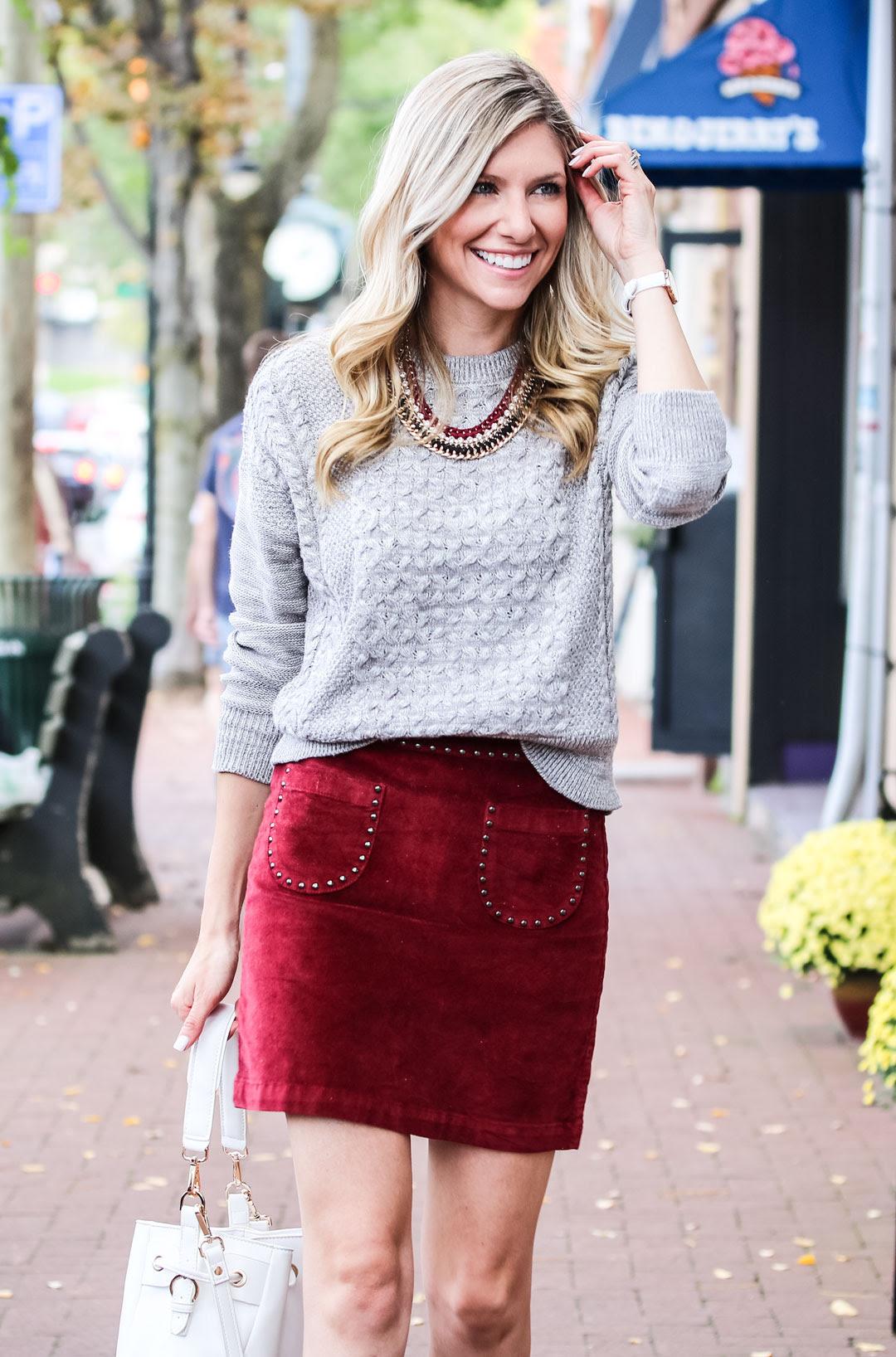 burgundy velvet skirt and white booties  the glamorous