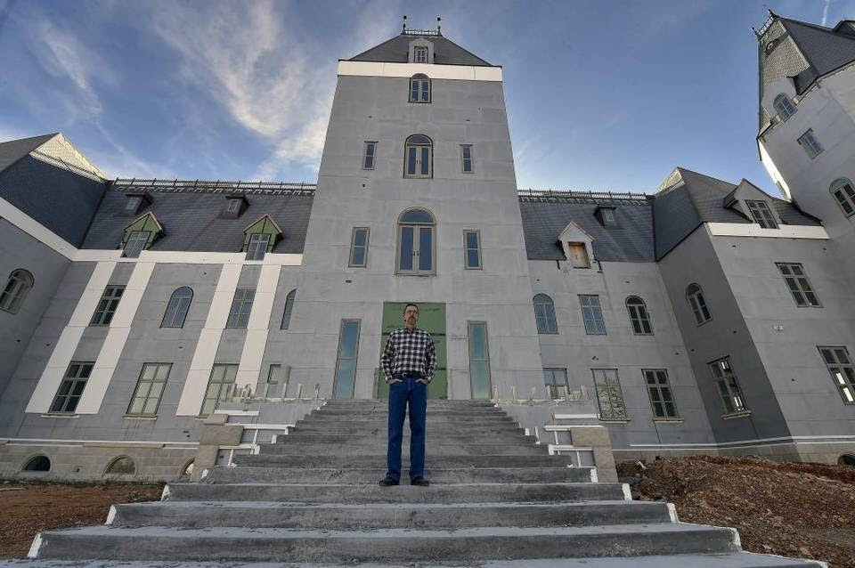 Steven T. Huff is completing his 72,000-square-foot concrete house near Highlandville, Mo. The exterior walls are 12 inches thick. The mansion has five floors, several elevators, 13 bedrooms —including five suites with kitchens — and 14 baths.