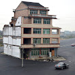 House In The Middle Of A Highway | Incredible Things