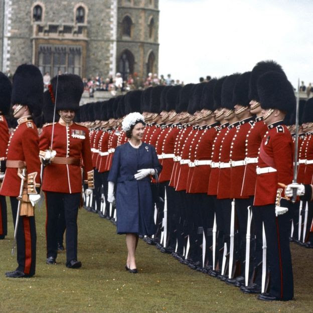 Inspecting the 1st and 2nd Battalions Coldstream Guards, at Windsor, as Sovereign.
