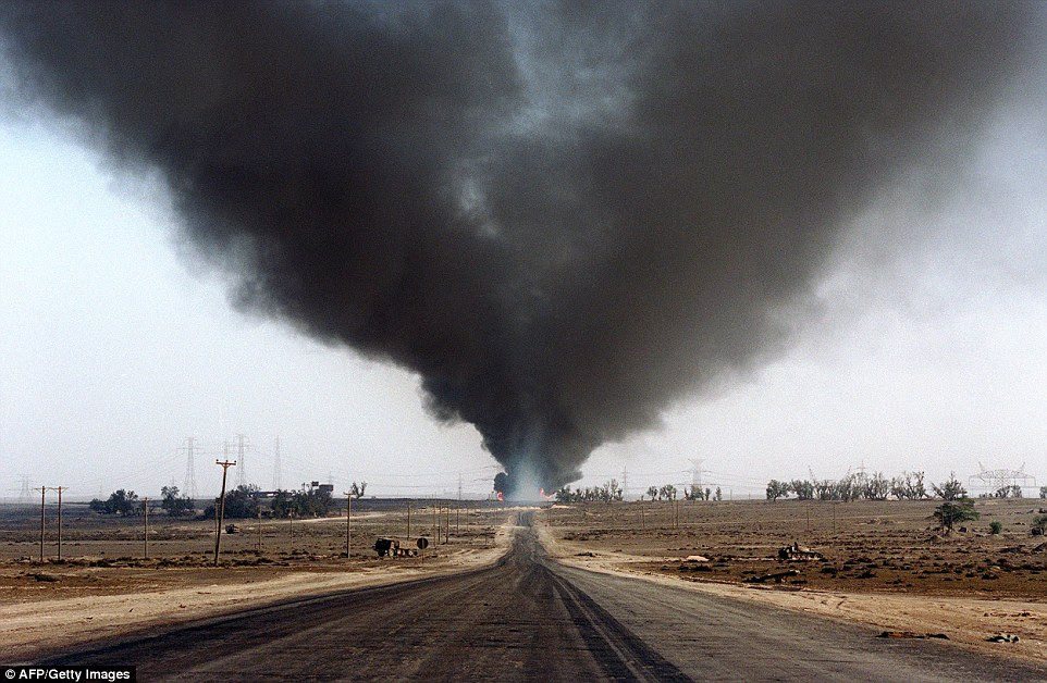 Several blown-out wells damaged by retreating Iraqi soldiers in Al-Ahmadi oil field burn in the Gulf War of 25 years ago