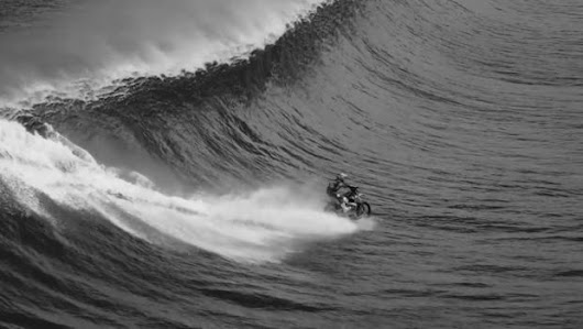 Robbie Maddison: Stuntman surfs on Tahiti wave with motorbike