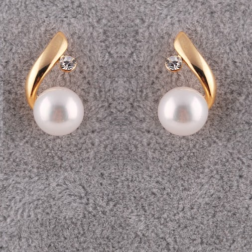 A playful and sparkling pair of drop pearl earrings with the addition of crystal diamond accents always...