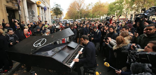 A pianist's spontaneous performance outside the Bataclan concert hall becomes one of the most shared responses to the Paris attacks