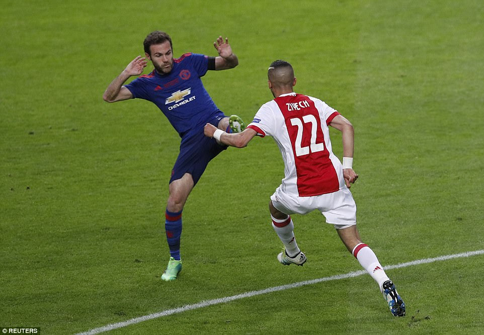 During the opening stages of the game, Ajax enjoyed the better of possession - pictured is Juan Mata looking to win the ball