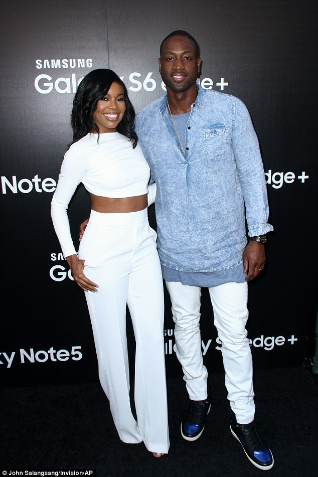 Snap: Her NBA star hubby meanwhile matched her with a pair of white jeans, which he coupled with sneakers, a grey T-shirt and a denim-style sweatshirt