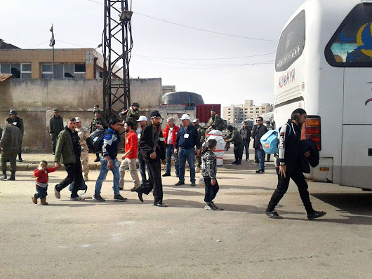 Final evacuation of Homs begins with messages of defiance from Syrian rebels