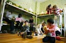 Orphan children play in their bedroom at an orphanage in the southern Russian city of Rostov-on-Don
