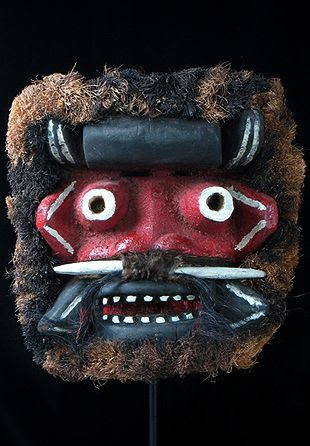 Guere mask Guere people, Liberia or Ivory Coast 12.5 inches, painted wood, fiber brush These masks are sometimes referred to as war masks. Actually, they are worn primarily during funerals and in a detective capacity to single out guilty persons. This is according to Jean-Baptiste Bacquart in his book The Tribal Arts of Africa. The staring eyes, nose spike and all those nasty teeth are very scary, especially at this large size. Sometimes shells, bells, nails and other hardware are attached.
