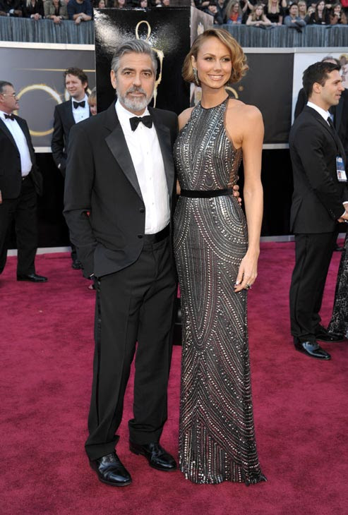 Actors George Clooney and Stacy Keibler arrive at the Oscars at the Dolby Theatre on Sunday Feb. 24, 2013, in Los Angeles.