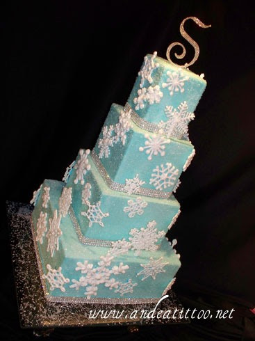 "New Year's Eve Blue Snowflake Cake! 12"", 8"", 6"" & 4"" tiers. The 12 & 6 are almond cake, other 2 are orange cake, all are chocolate ganach filled with Limoncello butter cream over all. The whole cake is covered in sparkling sugar and the snowflakes are royal icing, edible! Served 130. The wedding/reception were held at the Blair Center in Westfield Center, Ohio. Happy New Year everybody!"