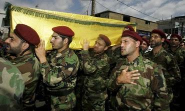 Hezbollah members at funeral of a Hezbollah fighter, May 26, 2013