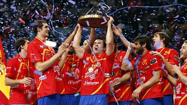 Spanish players celebrate with the trophy as they won the gold medal during the Men's Handball World Championship at the Palau Sant Jordi arena in Barcelona