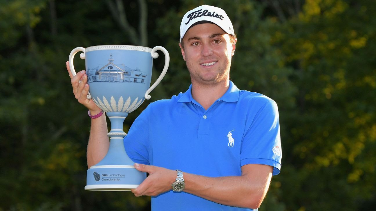 Justin Thomas with Dell trophy