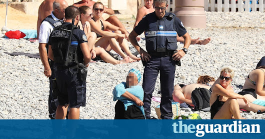 French police make woman remove clothing on Nice beach following burkini ban | World news | The Guardian