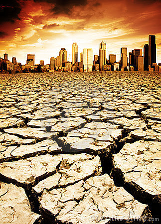 A city looks over a desolate cracked earth landscape. (Credit: www.dreamstime.com) Click to enlarge.