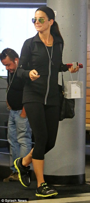 Fit: The mom-of-one showed off her amazing figure in form-fitting workout gear, which included a black tracksuit top, three-quarter length yoga pants and trainers
