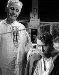 Clarence (left), consulting George Bailey in It's a Wonderful Life