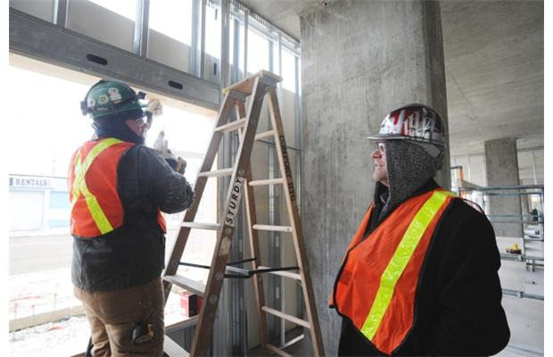 Mike Holmes talks with a worker as he inspects the new Boyle Renaissance Senior's project phase 2. A 90 unit seniors-friendly, barrier-free residential complex with features the latest in 'green' design  in Edmonton on December 21, 2012.