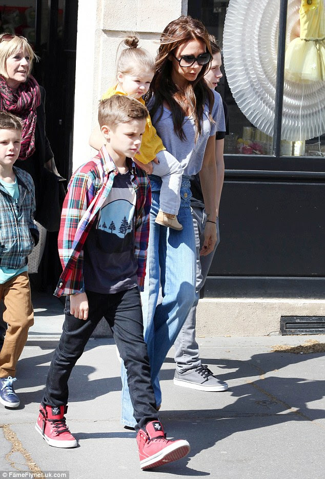 Family day: Victoria had all of her children and her mother with her for the day as they hit some of Paris' best kids' clothes stores