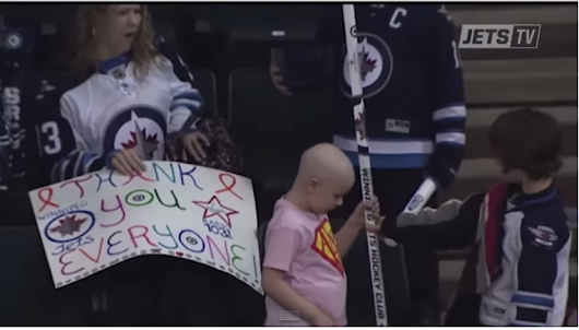 A Young Winnipeg Jets Fan Gives Girl Signed Stick At Game