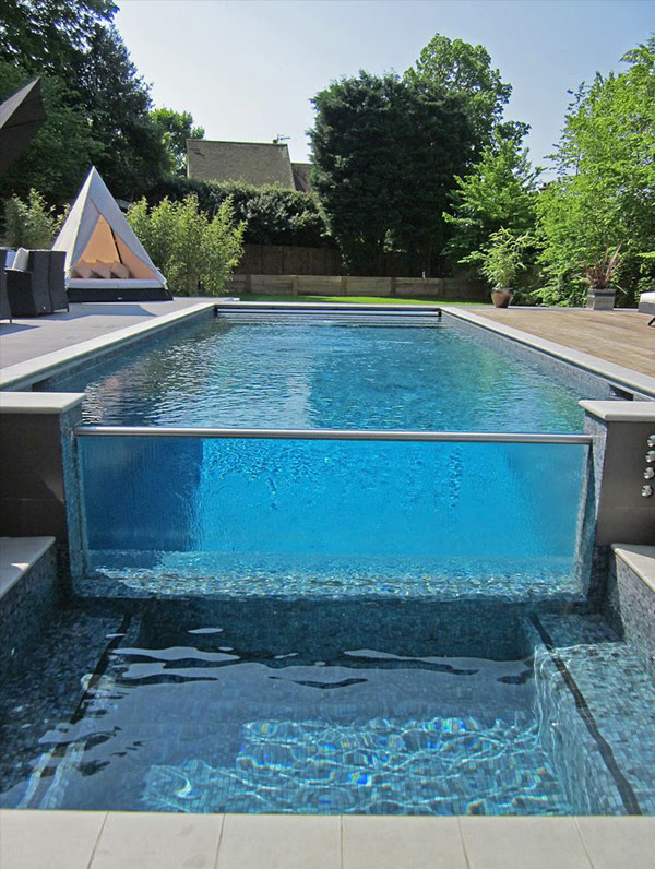 glass pool with outdoor furniture
