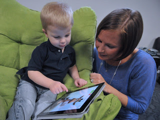 Child and mother with Apple iPad