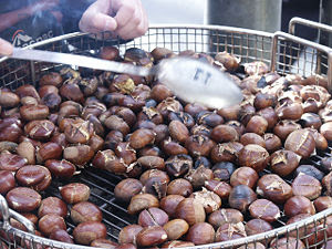 Roasted chestnuts being sold by street vendor