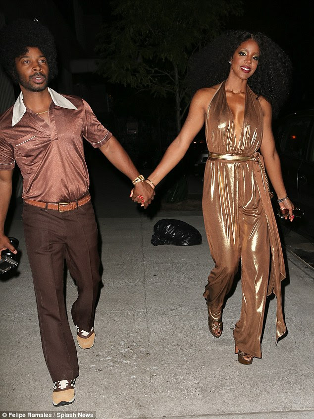 Disco diva: Kelly Rowland and her husband Tim Witherspoon matched in bronze tones