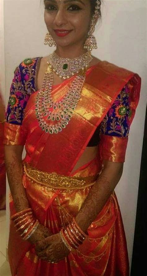 Glamorous South Indian Bride in a Vibrant Orange