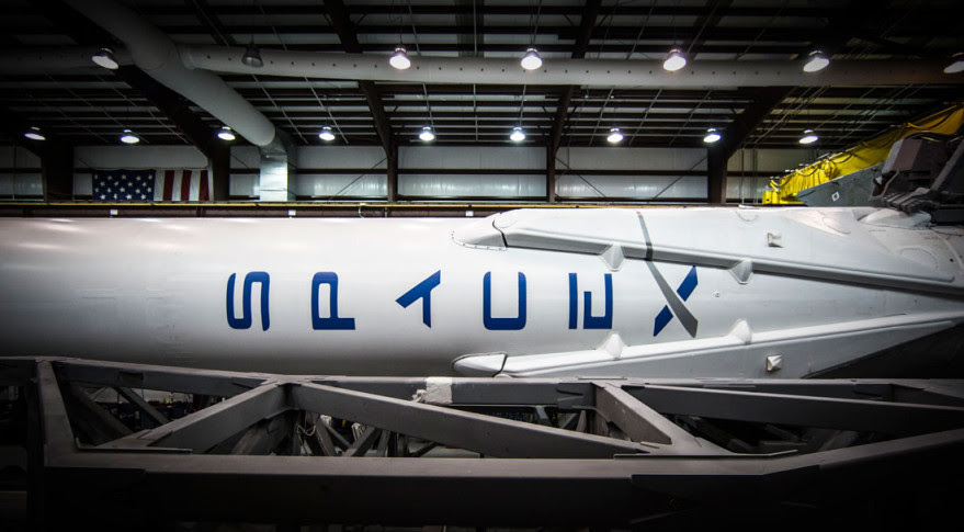 Falcon 9 in SpaceX's Cape Canaveral hangar in advance of the Orbcomm OG2 Mission 1. Credit: SpaceX