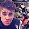 Risky business: Justin Bieber ditches helmet for a muddy four-wheeler bike ride