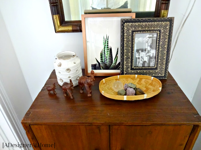 boho thrifted decorated hallway cabinet